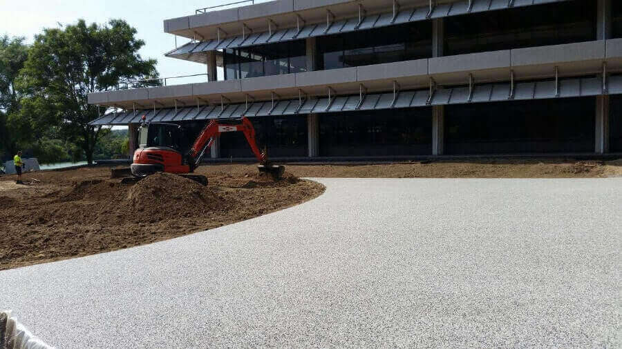 Our team installing commercial resin bound gravel surfacing in Bournemouth.
